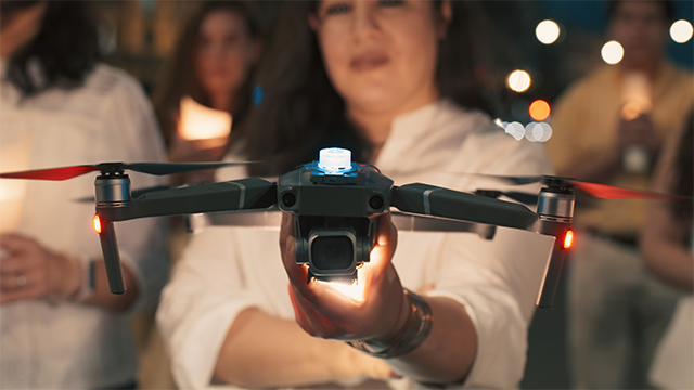 woman holds drone