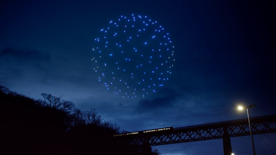 Drones form sphere in the night sky
