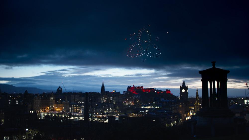 Drones form image in night sky against Edinburgh backdrop